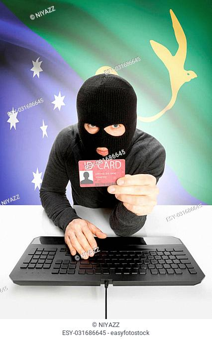 Hacker with ID card in hand and flag on background - Christmas Island