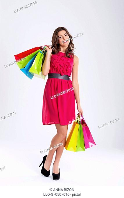 Smiling woman shopping, Debica, Poland