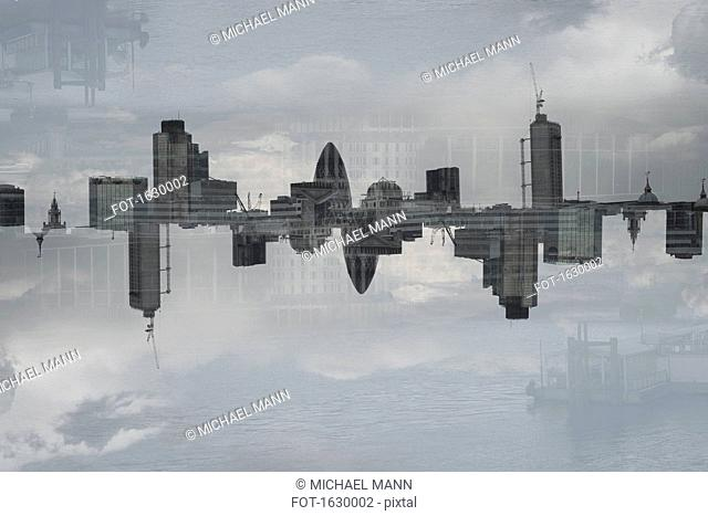 Multiple exposure of cityscape and cloudy sky, London, England, UK