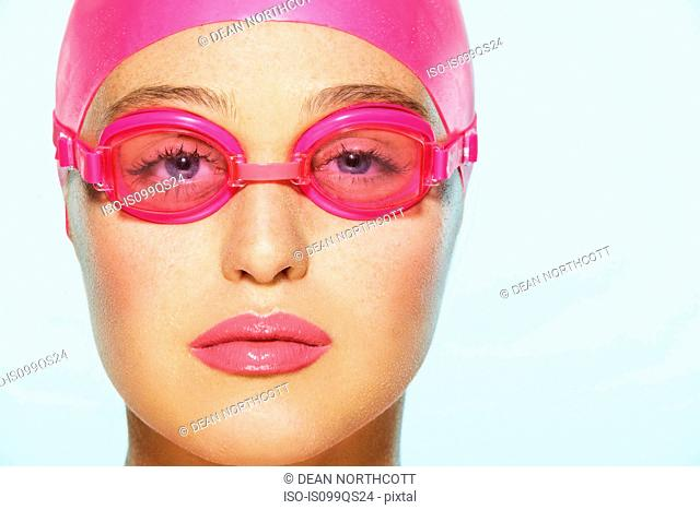 Female swimmer wearing pink swimming goggles