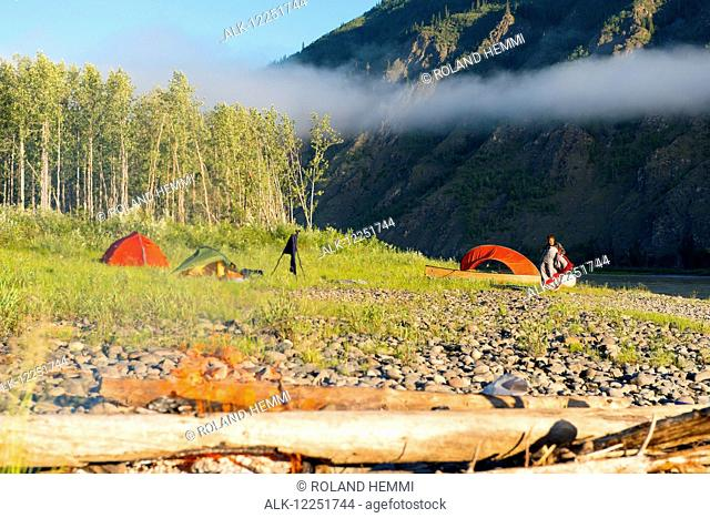 Scenic view of a campsite with morning fog along the Yukon River, Yukon Territory, Canada