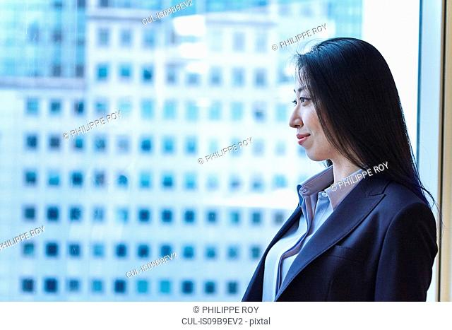 Portrait of businesswoman looking out of window