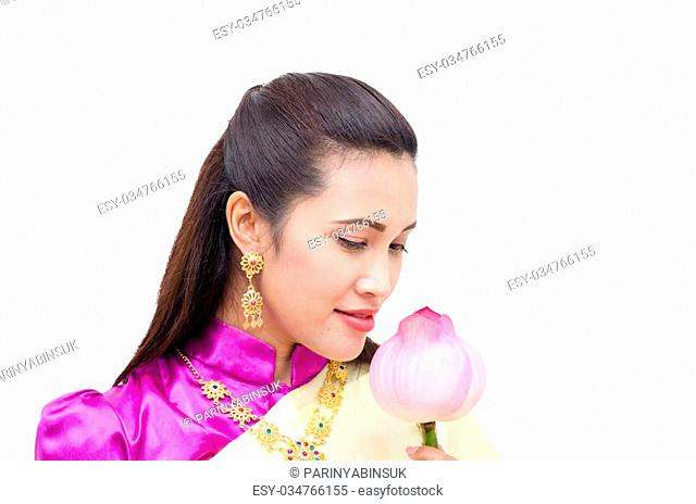 Thai woman in traditional costume with lotus isolated over white