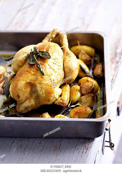 Roasted chicken with sage,roasted potatoes and garlic