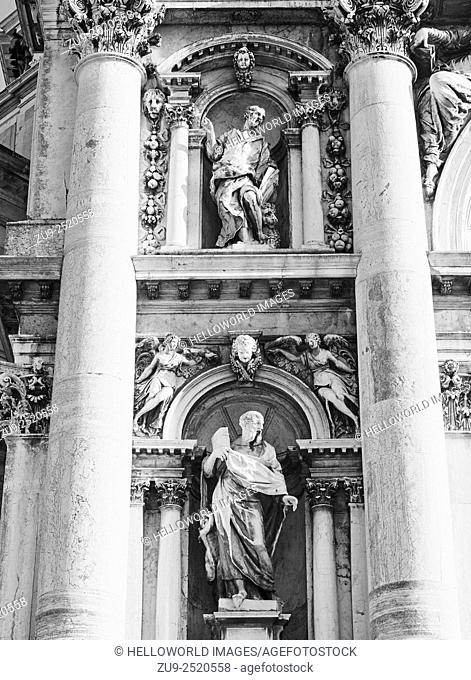 """Statues on facade of Basilica di Santa Maria della Salute Roman Catholic church. It is the most recent of the """"""""plague churches"""""""" built as an offering for the..."""