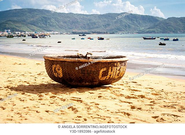 Vietnam, typical fishing boat on the beach in Qui-Nhon