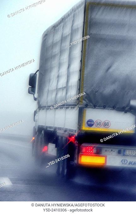 truck on a highway in heavy rain