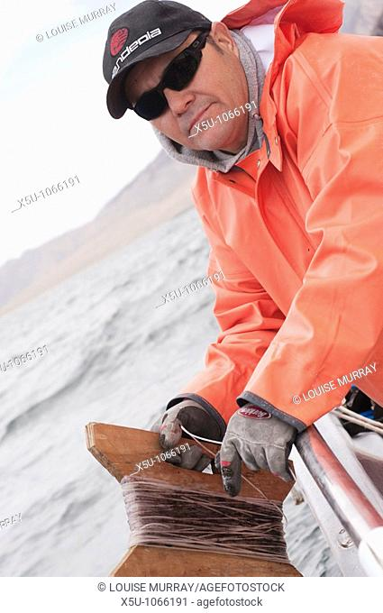 Fisherman with long line or handline jigging for humboldt or jumbo squid