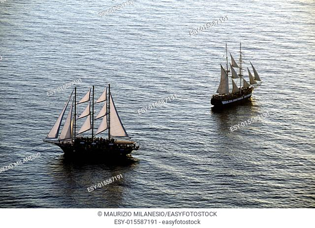 Sailing ships in the bay of Santorini Greece