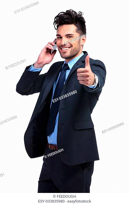 young business man with very good news on the phone making the ok thumbs up hand gesture
