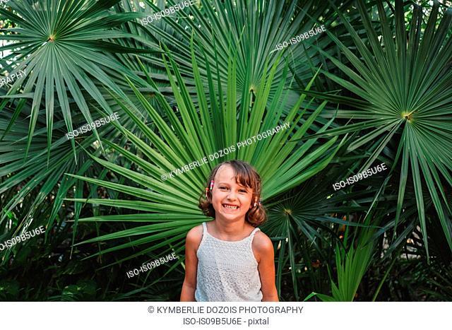 Girl in front of fan palm tree