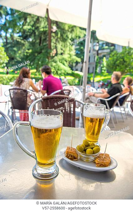 Two glasses of beer and tapa in a terrace. Madrid, Spain