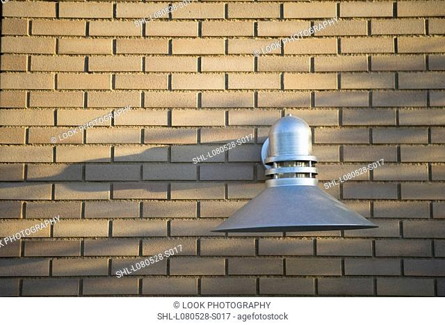 industrial style exterior wall light on brick wall