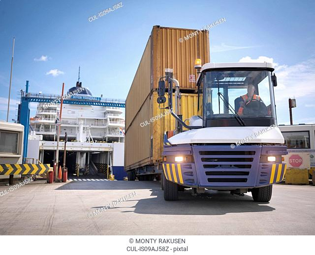 Truck unloading containers from ferry to port