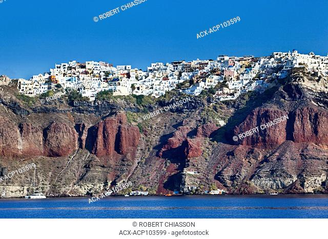 High cliffs on top of which is the town of Oia on the island of Santorini, Greece