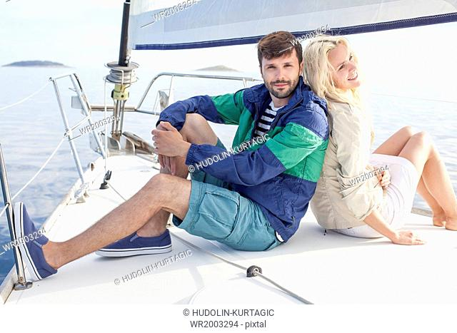 Young couple relaxing on sailboat, Adriatic Sea