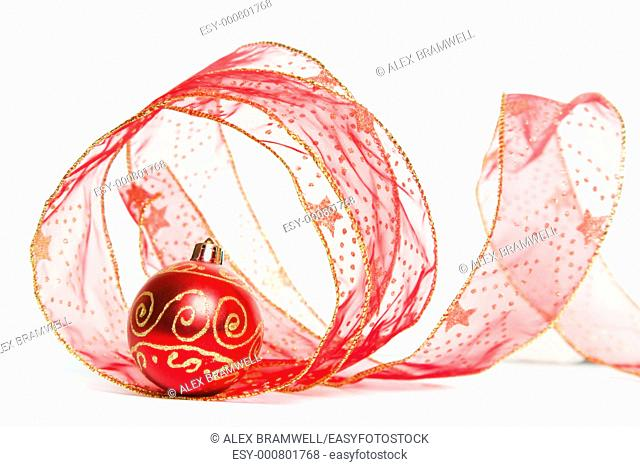 Christmas Ribbon and Bauble over a white background