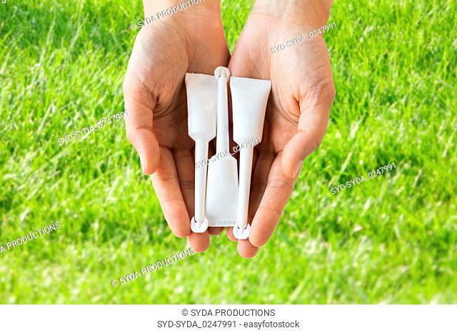 hand holding tubes of micro enema
