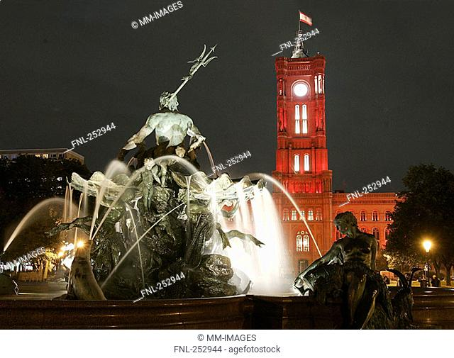 Town hall and fountain lit up at night, Berlin, Germany