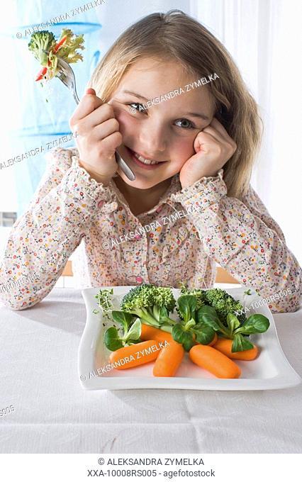 girl eating vegetable