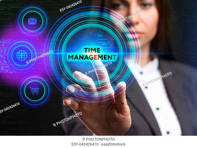 The concept of business, technology, the Internet and the network. A young entrepreneur working on a virtual screen of the future and sees the inscription: Time...