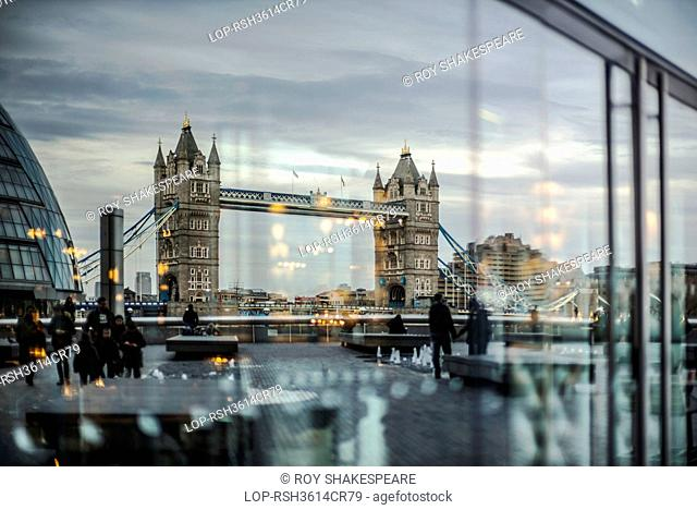 England, London, Southwark. Tower Bridge reflected in glass from the south side
