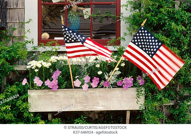 Window boxes in town of Nantucket with USA flags celebrating the 4th of July. Nantucket Island. Massachusetts. USA