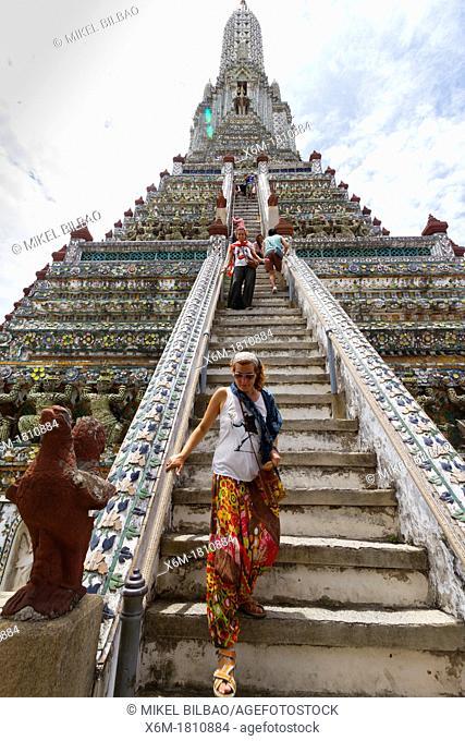 Tourist in the prang  Wat Arun Rajwararam or Temple of the Dawn  Bangkok, Thailand