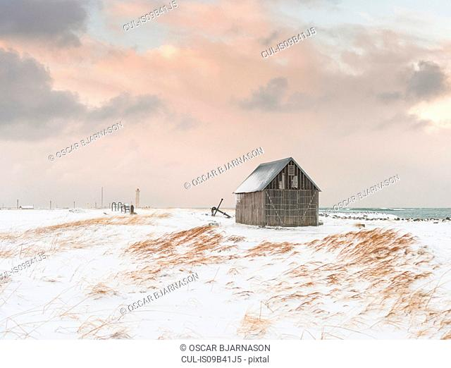 Lone hut on snow landscape, Seltjarnarnes, Iceland