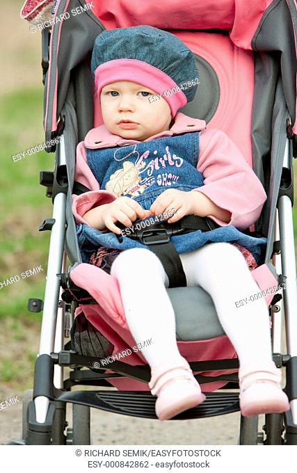 toddler sitting in a pram on walk