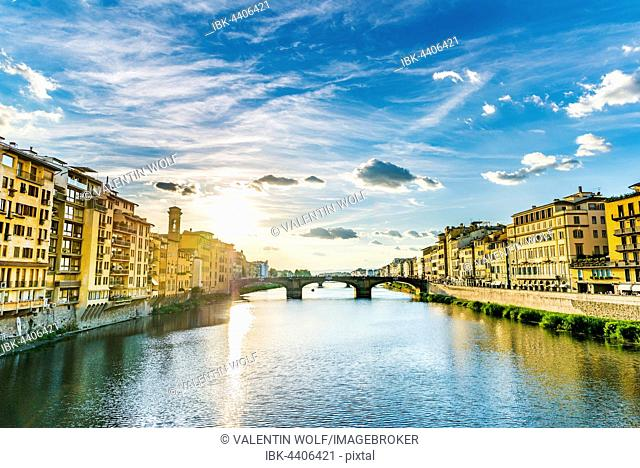 View of Ponte Santa Trinita bridge from Ponte Vecchio over Arno River, Florence, Tuscany, Italy