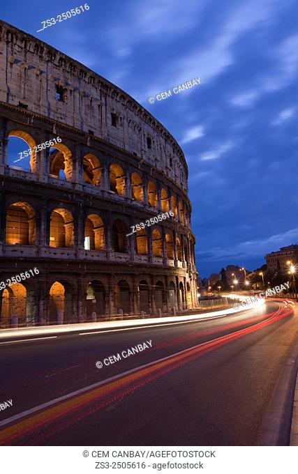 The Roman Colosseum and car light-trails at night, Rome, Lazio, Italy, Europe