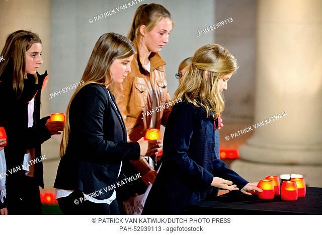 Princess Elisabeth of Belgium (R) attends a First World War commemoration, in Ploegsteert, Belgium, 17 October 2014. The Lichtfront will illuminate the front...