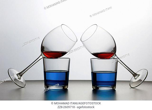 four glasses of drink on display