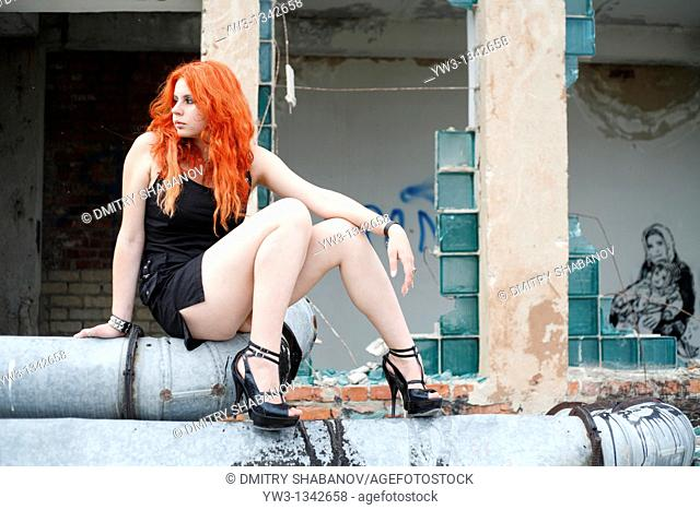 pretty redhead girl on the pipes