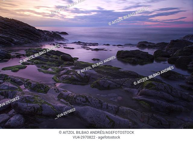 Long exposure of the small beach of Kobaron, a Little town of the Basque Country coast