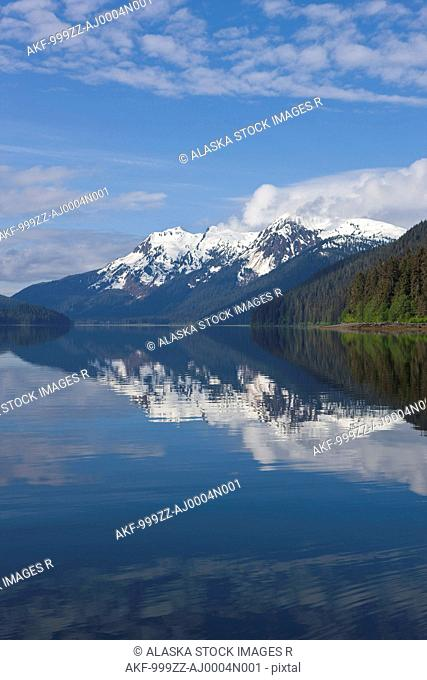 Clouds reflected in the calm waters of Seymour Canal, Admiralty Island, Tongass National Forest, Alaska, Windfall Island, Southeast Alaska, Summer