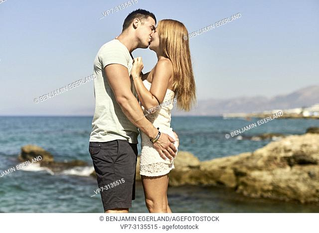 Couple in summer holiday, kissing. Crete, Greece