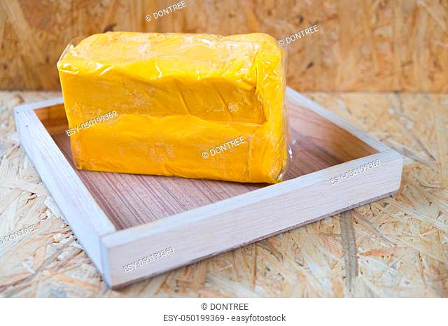 whole block butter on wood tray on wood table