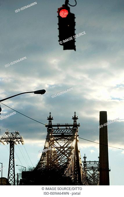 Traffic light and urban bridge
