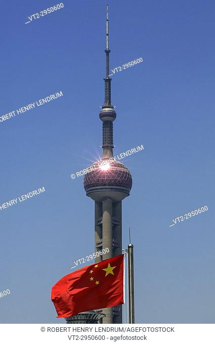 The flag of the People's Republic of China and the Oriental Pearl Radio TV Tower, Shanghai, China