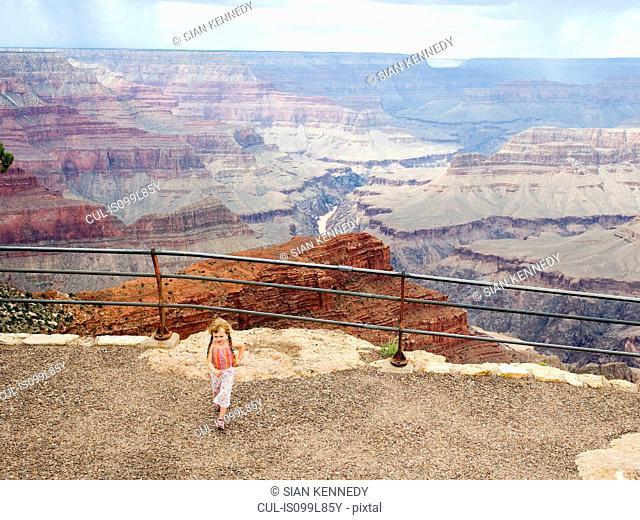 Girl walking away from canyon edge
