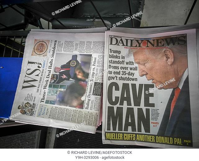 Headlines of New York newspapers on Saturday, January 26, 2019 report on the temporary ending of the government shutdown. (© Richard B. Levine)