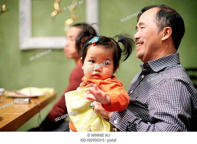 Toddler and grandfather at thanksgiving dinner
