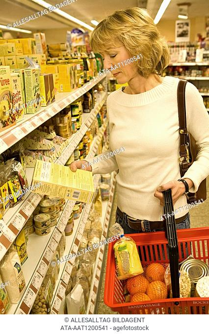 Woman buying eco-products in the supermarket
