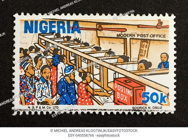 NIGERIA - CIRCA 1980: Stamp printed in Nigeria shows a modern post office 1980