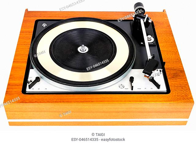 Vintage turntable vinyl record player isolated on white. Wooden plinth. Retro audio equipment