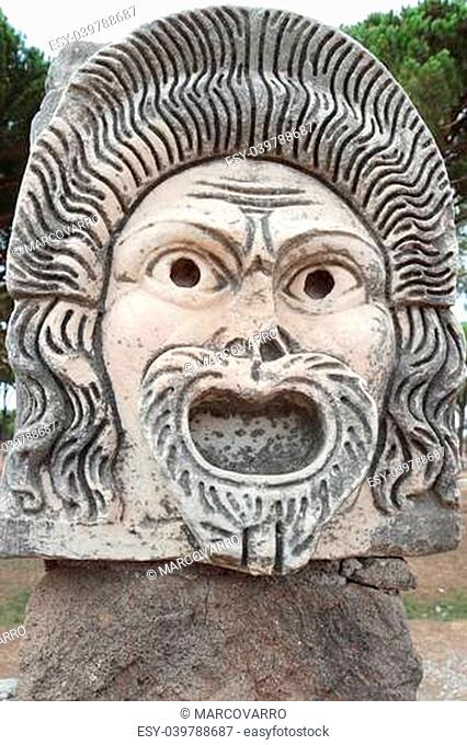 mask detail in Ostia Antica theater, Rome, Italy