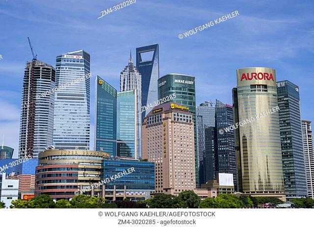 View from a Huangpu River cruise of the modern center of Pudong and the 492 meter high World Financial Center, Shanghai, China