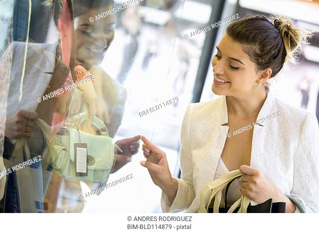 Caucasian woman shopping in mall